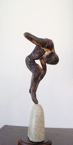 Carl Roberts. Female figure, wood Sculpture. info@artisan.co.za.