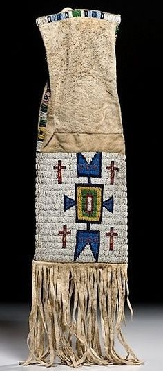native american, America, Sioux beaded hide tobacco bag, circa 1900, sinew-sewn using bead colors of red white-heart, cobalt, medium blue, greasy yellow, pea green, and white.