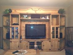 Rustic pine Entertainment center with long horn carvings