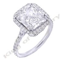 This beautiful Radiant Cut Diamond Engagement ring is stunning. It features a gorgeously sparkling 1.51 ct Radiant Cut Diamond in the center Set in a beautiful design with round cut diamonds set around the center. All the diamonds are prong set for a superb shine and beauty!