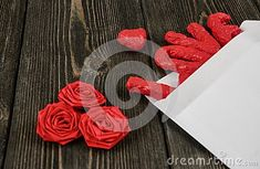 White envelope, word Love, heart and three roses on wooden background