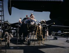 Employees at North American's plant put the finishing touches on another B-25 bomber - From Alfred T Palmer
