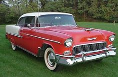 I had a 55 Chevy just like this one and it was awesome .