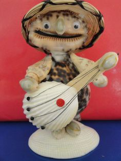 Sea Shell Musician Guitarist Figurine Philippines...looks like he forgot to put in his dentures!!