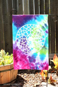How to Tie Dye and Upcycle an Old T-Shirt into a Colorful  Garden Flag - Happiness is Homemade