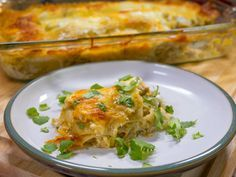 Spicy Green Chili Chicken Lasagna •4 cups cooked chicken, shredded or cubed •2 cups salsa verde •2 cups mozzarella cheese, grated •2 cups Mexican cheese blend •3/4 cup sour cream •10 oz. no-boil lasagna noodles •1 (15 oz.) container crema •1 (10 oz.) can fire roasted green chiles •1 teaspoon cumin •1 teaspoon chili powder