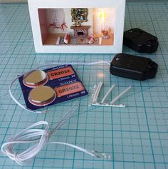 DIY supplies to make OOAK dollhouse lights with wired LED bulb On off switch battery holder 3 volt batteries and heat shrink tubes