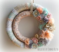 Beautiful soft pink, tiffany blue and gold double wrapped wreath. Made by Wreaths By Emma Ruth