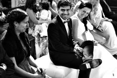 A mischievous grin from the groom, a knowing smile from the bride, and a surprised laugh make this photo of a shoe note. Thanks to Portuguese wedding photographer Luis with Quemcasaquerfotos!
