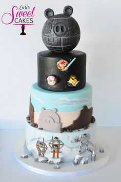 My son's birthday theme this year was Angry Birds Star Wars. His attention to detail is remarkable for a 7 year old. We butted heads a few times as we designed this cake, and we both shed a few tears! Once the cake was complete we were both really happy with how it turned out.