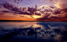 Preview wallpaper lake, mountains, sky, evening, reflection, ripples, surface of the water, colors