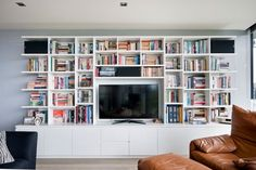 Size: wide x high x deep Materials: White laminate to match wall colour. Living Room Wall Units, Living Room Shelves, Home Living Room, Tv Bookcase, Bookshelves With Tv, Living Room Entertainment Center, Entertainment Units, Muebles Living, Library Wall