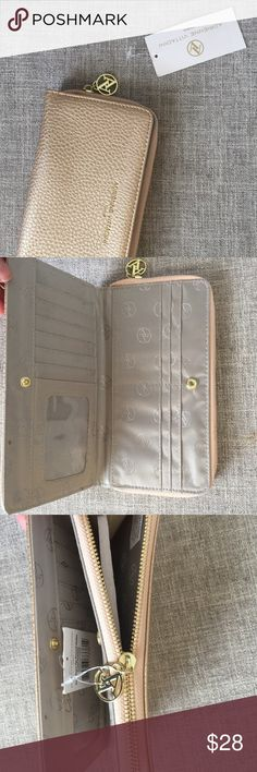 NWT Adrienne Vittadini gold pebble wallet Gorgeous zip around snap front wallet in gold pebble color. Gold accents, lots of organization. Bundle to save or make an offer! Adrienne Vittadini Bags Wallets
