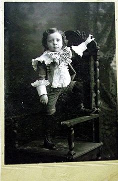 Little Lord Fauntleroy suits: often in velvet with a white lace collar- curls in the hair