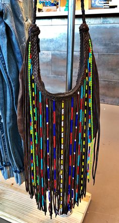 Long fringe purse with beaded detail.