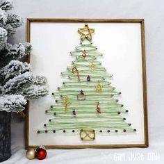 Make this beautiful String Art Christmas Tree with Wire for a stylish twist and dimensional interest over a typical string art project. Handmade Christmas Crafts, Homemade Christmas Decorations, Wooden Christmas Trees, Noel Christmas, Christmas Crafts For Kids, Holiday Crafts, Holiday Decor, Holiday Ideas, Christmas Ideas
