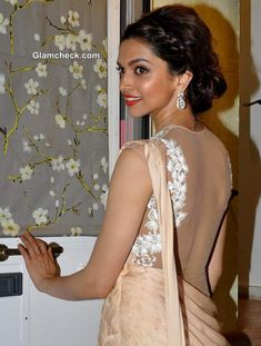 Deepika Padukone in a sari-gown with a lace blouse