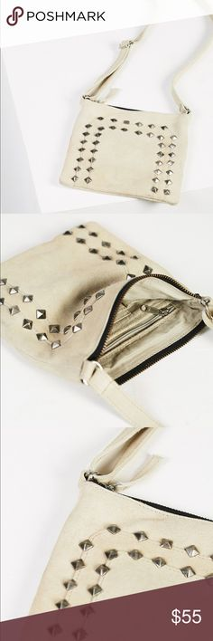 """Free People Calexico Crossbody Studded Star Bag Authentic   New Ivory Suede Coachella Festival Free People Calexico Crossbody Studded Star Bag  Style: 39924519   Western meets glam in this small suede crossbody bag with front scattered stud embellishments. Several inside pockets.  Top zipper closure.  Adjustable strap.  Inner: 100% Cotton Outer: 100% Suede Product measurements Height: 7.5""""  Width: 7.5""""  Strap: 45""""   SOLD-OUT EVERYWHERE!  As seen on tons of celebrities!   Please message me…"""