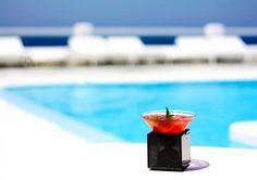 Kourohito cocktail by Kouros pool overlooking the Aegean Sea...