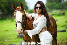 Sony Charishta Latest Hot Photoshoot - Indiansite - Beautiful Sony Charishta in White Dress with Horse