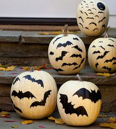 Give your outdoor decor a Halloween touch with these bat covered pumpkins. More Halloween decorating: http://www.bhg.com/halloween/outdoor-decorations/outdoor-halloween-decorating-with-pumpkins/?socsrc=bhgpin090513batpumpkins