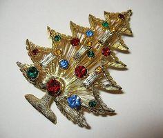 Ooohh Christmas Tree! Brooks vintage rhinestone tree brooch: http://www.etsy.com/listing/81196913/rhinestone-christmas-tree-brooch-brooks