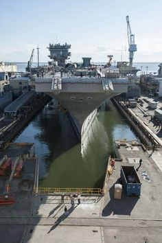 Enterprise (CVN 65) Enters Dry Dock 11 - The first super carrier powered by nuclear reactors, USS Enterprise is also the first to undergo an inactivation, which includes defueling the ship's eight reactors and preparing the hull for its final dismantlement. Photo by Dar Deerfield-Mook/HII