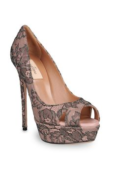 I actually have something like these ... they're closed-toe with skulls =D
