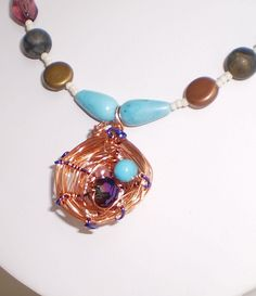 Nest Egg--  Hand-wrapped wire, turquoise, and glass  sarah@crystalpaintbrush.com