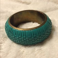 """VTG Turquoise Wicker & Brass Wide Bangle Bracelet A gorgeous statement piece and staple for the summer! This Wide Bangle Bracelet has a brass inner lining and a Hand Weaved Wicker Turquoise outer design. Measures 2-1/2"""" opening; 4"""" wide in diameter overall. In excellent preowned condition. Smoke-free home. Vintage Jewelry Bracelets"""