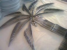 lay the silverware in the shape of a palm tree