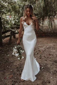 This simple yet elegant wedding gown features a V-neckline with open back, slim bodice with a sweep train. It can be custom made to your exact measurements. gown satin V-neckline Backless Simple Boho Wedding Dresses 2020 from NarsBridal Wedding Dress Black, Chic Wedding Dresses, Simple Elegant Wedding Dress, Backless Wedding Dresses, Minimal Wedding Dress, Wedding Dress Bohemian, Wedding Dress Sheath, Lace Dresses, Dress Lace