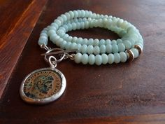 Light Blue Amazonite necklace with an Ancient roman coin pendant, Statement necklace, birthstone necklace, Amazonite strand necklace by anakim on Etsy https://www.etsy.com/listing/179306401/light-blue-amazonite-necklace-with-an