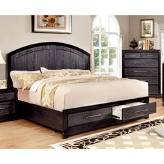 For the bold couple, this two-tone storage bed offers a unique design that's sure to compliment any contemporary home. The arched panel headboard and 2-drawer footboard mimic wood grains while finished in a moody grey.