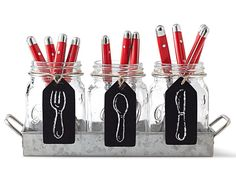 This mason jar caddy with chalkboard labels makes for a charming way to present flatfare at outdoor parties. About $30 from Bed Bath & Beyond