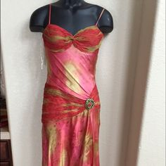 """BEAUTIFUL SILK GOWN"" JUST IN TIME FOR PROM!! Beautiful silk red rust and green gown. High-Low style yet still long enough on the front (below knee). Hidden side zipper and small train. It does not have a tag but it is a size 2 and fits a 34B bust. No pulls, rips or stains. Dresses High Low"