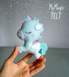 This item is MADE TO ORDER, production time 2-3 weeks This is a very cute little Pegasus made of felt. You can use this ornament to embellish your