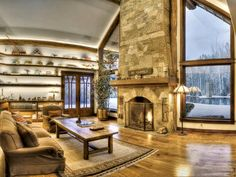 floor to ceiling fireplaces between windows | In the living room, a floor-to-ceiling fireplace is flanked by windows ...