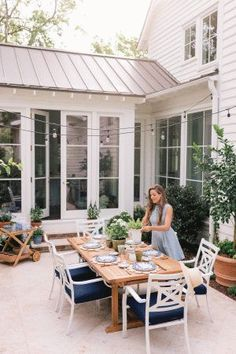 LIFESTYLE INFLUENCER GAL MEETS GLAM Gal Meets Glam HOME IMPROVEMENT SUPPLIER Lowe's Farmhouse Style Bedrooms, Farmhouse Bedroom Decor, Back Patio, Backyard Patio, Diy Exterior, Sunroom Decorating, String Lights Outdoor, Backyard Makeover, Outdoor Living