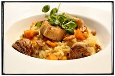 RISOTTO Pumpkin Risotto with fried scallops and chestnuts.