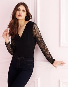 This long sleeve lace bodysuit from Lipsy is the perfect transitional piece to take you from the boardroom to the bar. Its bodycon design fits smoothly to curves, while the lace arm gives it a unique twist!