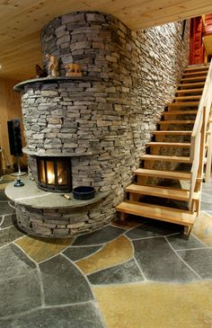 Stone work from stairwell that turns into a fire place. Simply beautiful
