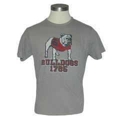 UGA Mens Gray Devil Dog Over Bulldogs 1785 Tee. University of Georgia mens gray t-shirt with vintage standing bulldog over BULLDOGS over 1785 in red with block shadows