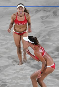 Nadine Zumkehr and Joana Heidrich of Switzerland react during the Women's Beach Volleyball preliminary round Pool E match against Karla…