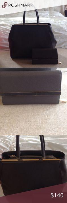Genuine Danier leather handbag Genuine leather Danier Handbag in top notch condition! Zero damage and unnoticeable wear! Amazing quality ! Nice statement handbag! Wallet sold separately Bags Shoulder Bags