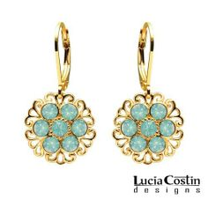 Superb Dangle Earrings by Lucia Costin with Filigree Details and Mint Blue Swarovski Crystal Flowers; 24K Yellow Gold Plated over .925 Sterling Silver; Handmade in USA Lucia Costin. $48.00. Unique jewelry handmade in USA. Irresistible dangle earrings by Lucia Costin. Beautifully crafted with blue opal Swarovski crystals. Flowers and fancy details amazingly combined. Update your everyday style with inspiration when wearing this piece of jewelry
