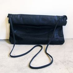 Image of Yvonne Koné oversized rolled clutch