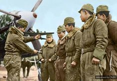 "Captain Ichikawa in front of his Kawasaki Ki-61 Hien ""Tony"" fighter, explains maneuvers to confront B-29 bombers. Chofu Airfield, near Tokyo, Japan. February 1945. Ichikawa became one of the top aces downing nine B-29 in the final months of the war."