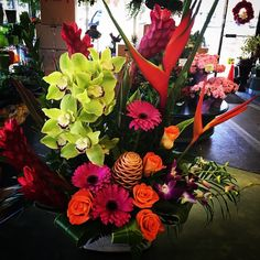 Another #bold, #tropical #arrangement! #Orange, #pink, #lime green and our usual fun tropical flowers!
