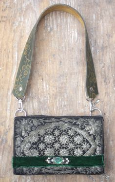 vintage beaded bag repurposed with mesh and velvet ribbon. Leather tooled belt as a handle